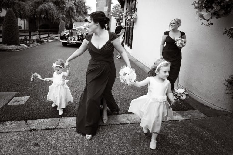 Bridemaids and flowergirls arriving at church