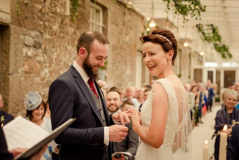 Couple laughing at altar at Boyne Hill House wedding
