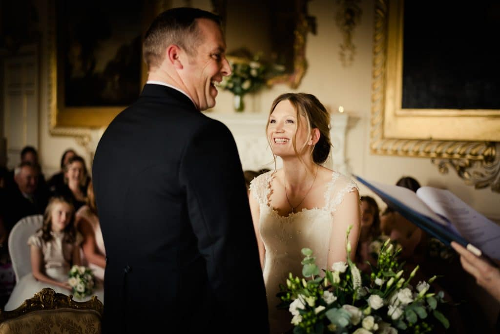 Laughing couple exchanging vows in Carton House