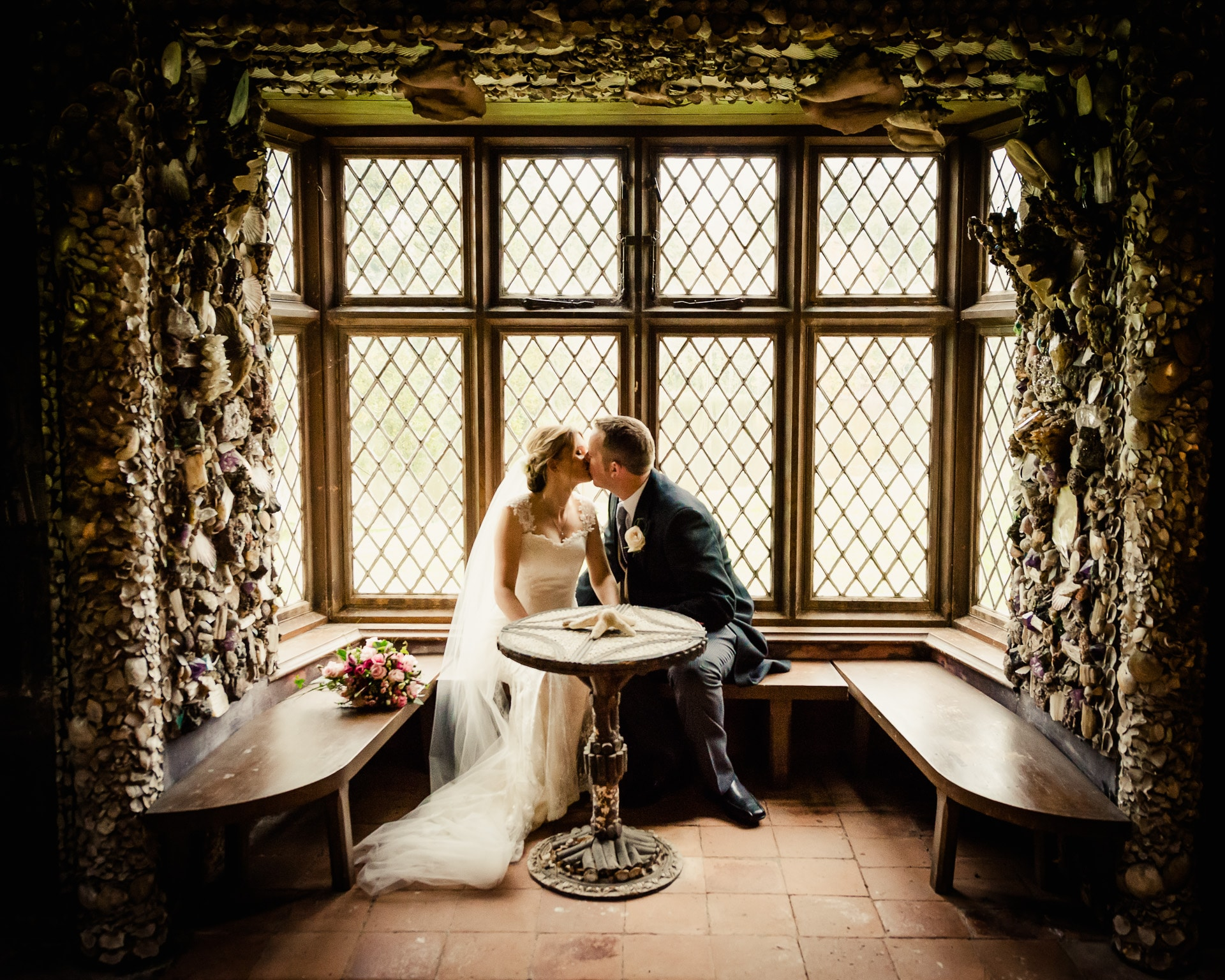 Wedding couple kissing inside shell cottage at Cliff at Lyons