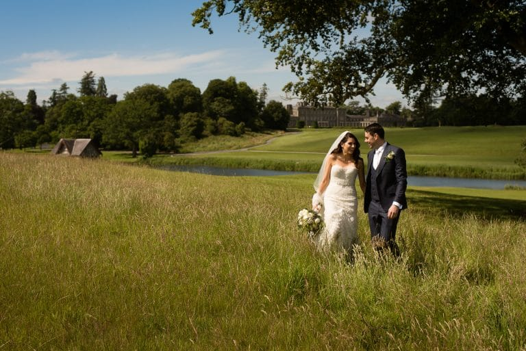 Wedding couple walking in Carton House grounds