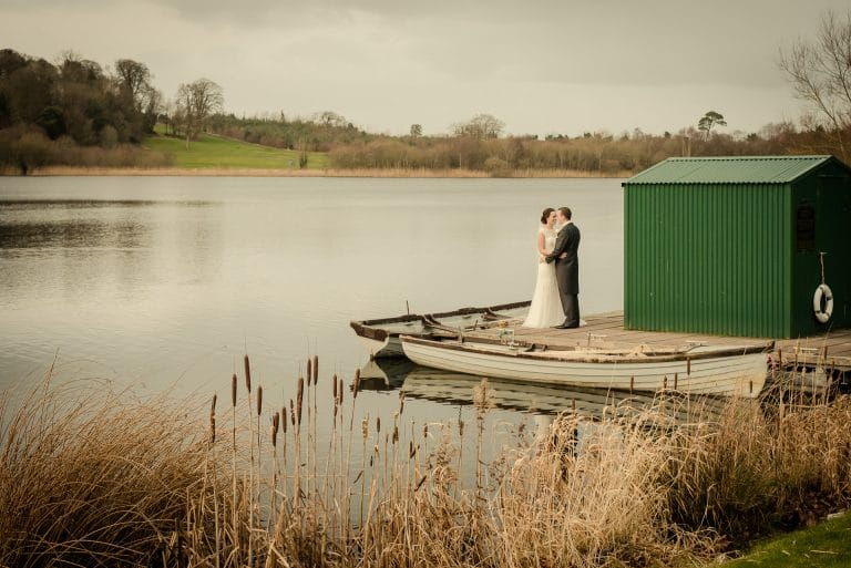 Wedding couple at boathouse in Dromoland Castle