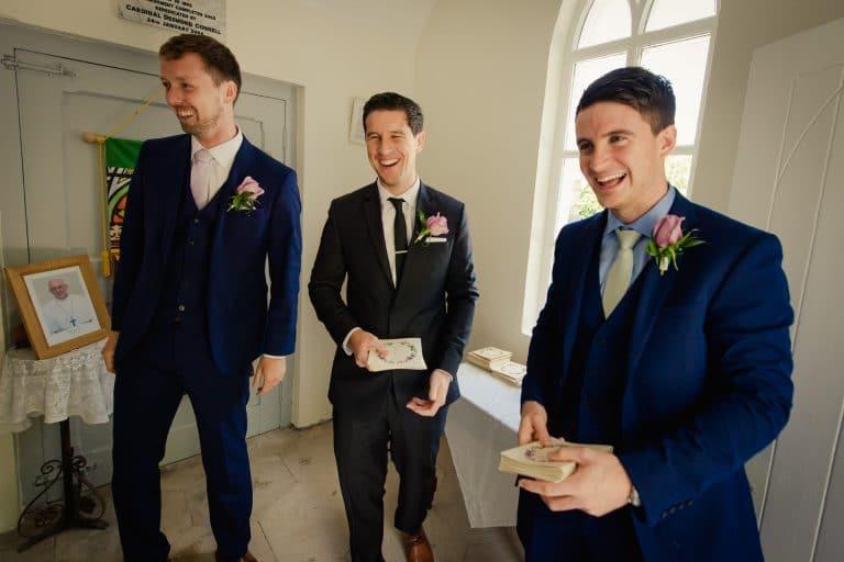 Laughing groomsmen in Kilquade Church