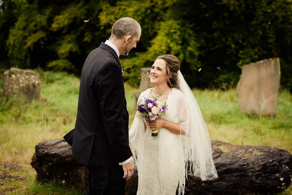 Smiling eloping couple exchange vows at Kinnitty Castle stone ciircle