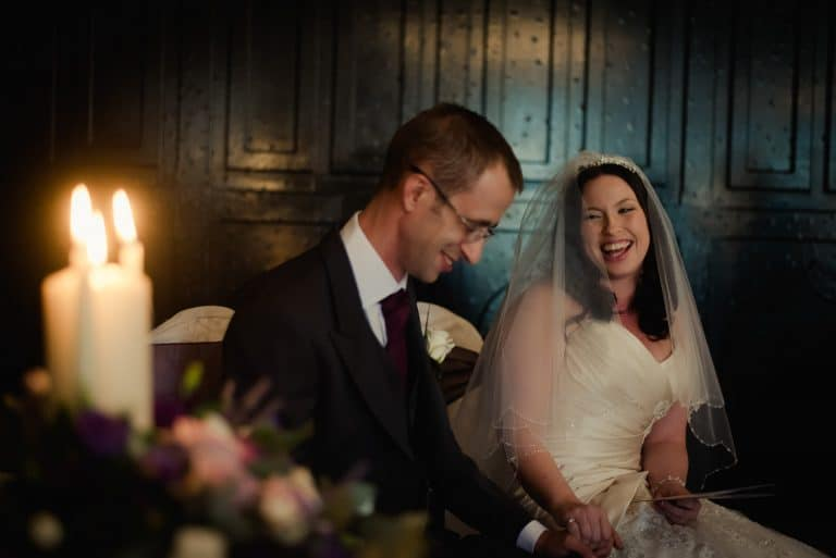 Laughing bride during wedding ceremony in Kinnitty Castle