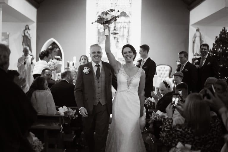 Celbrating wedding couple at Kinnitty church