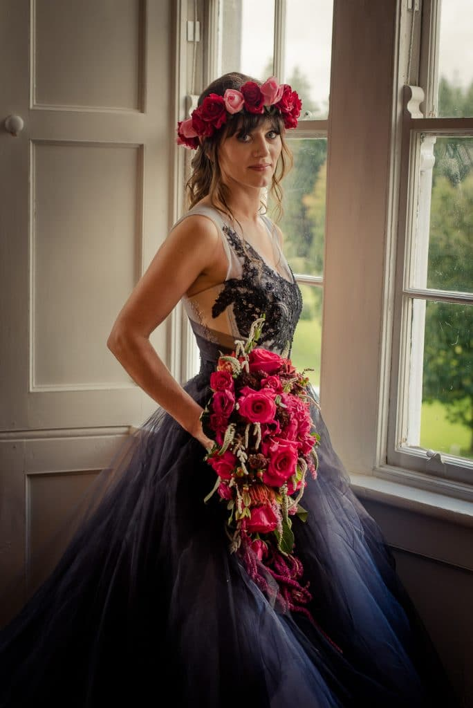 Posed bridal portrait in black dress at Kinnitty Castle
