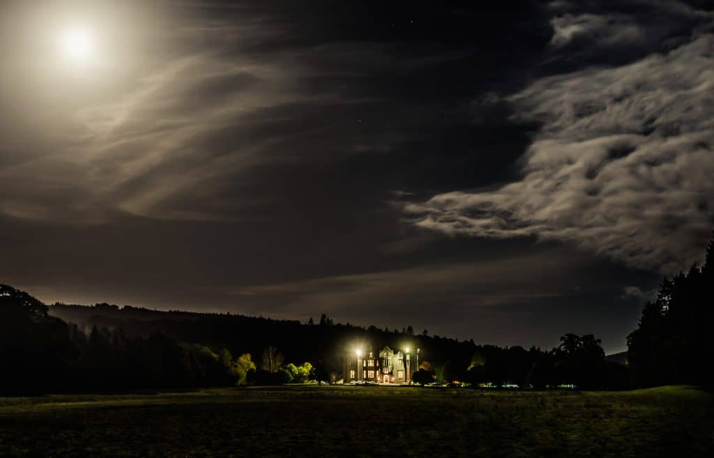 Moonlight and clouds over Kinnitty Castle at night