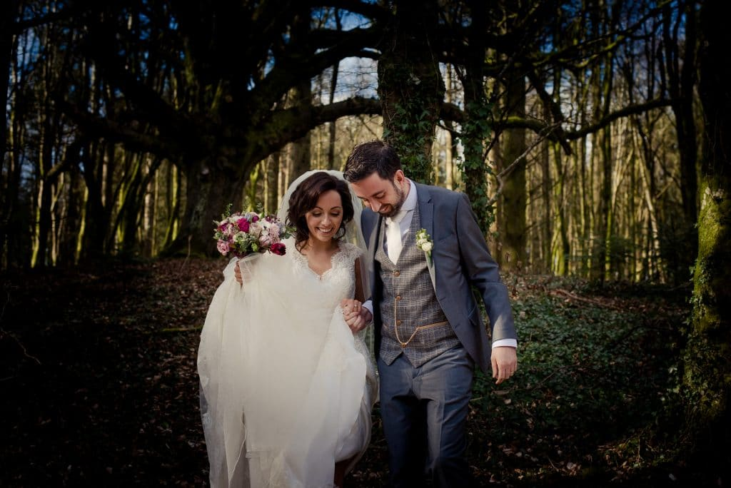 Wedding couple walking in Kinnitty Castle woods
