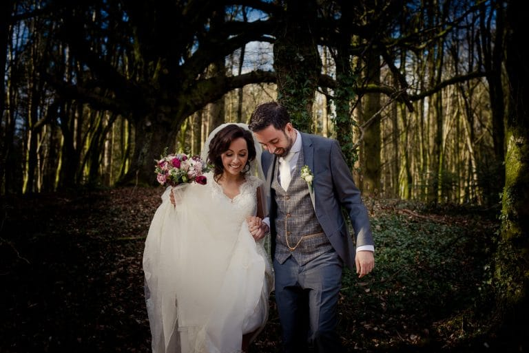 Wedding couple walking in Kinnitty Castle woods