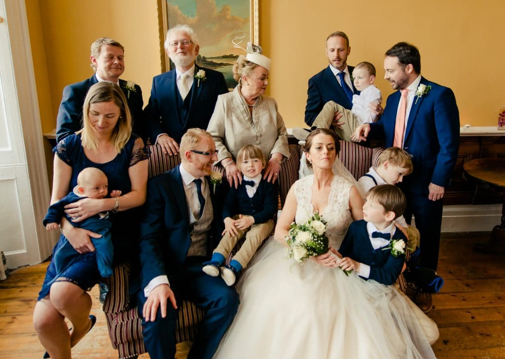 Funny wedding group photo with only 1 person out of 13 looking at camera