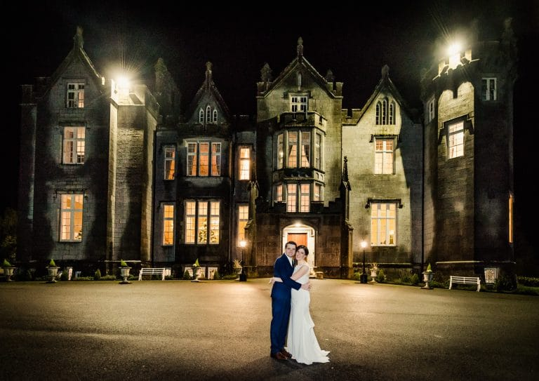 Couple posing at night in front of Kinnitty Castle