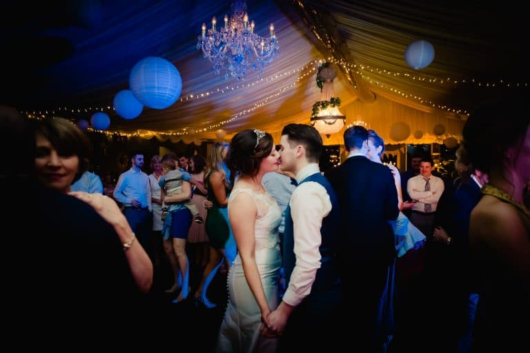 Wedding couple kissing on dance floor in Tinakilly House
