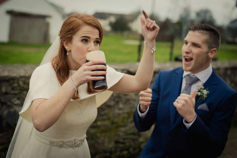 Bride drinking pint of Guinness in Hollywood Inn