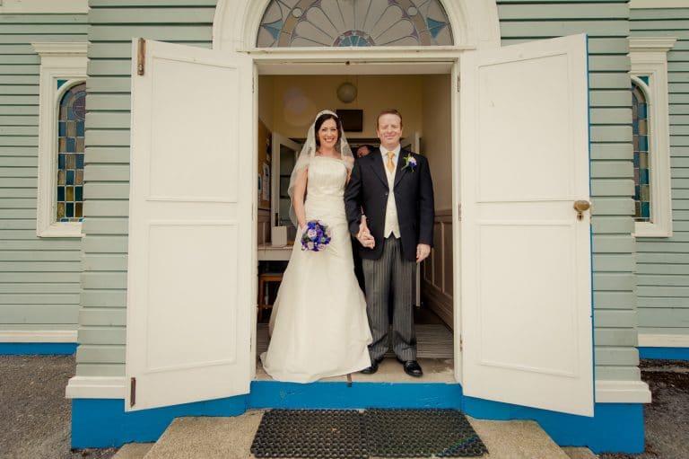 Wedding couple in doorway of Our Lady of the Wayside church Kilternan
